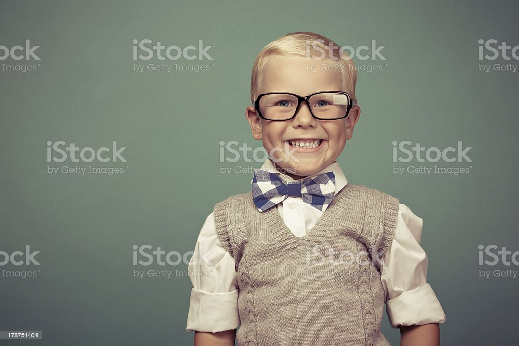 A portrait of a Small smartly dressed boy with glasses  stock photo
