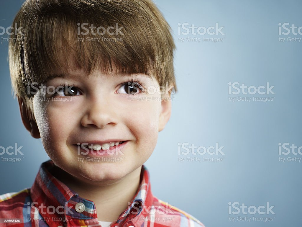 Portrait of a smiling 3 year old boy.  royalty-free stock photo