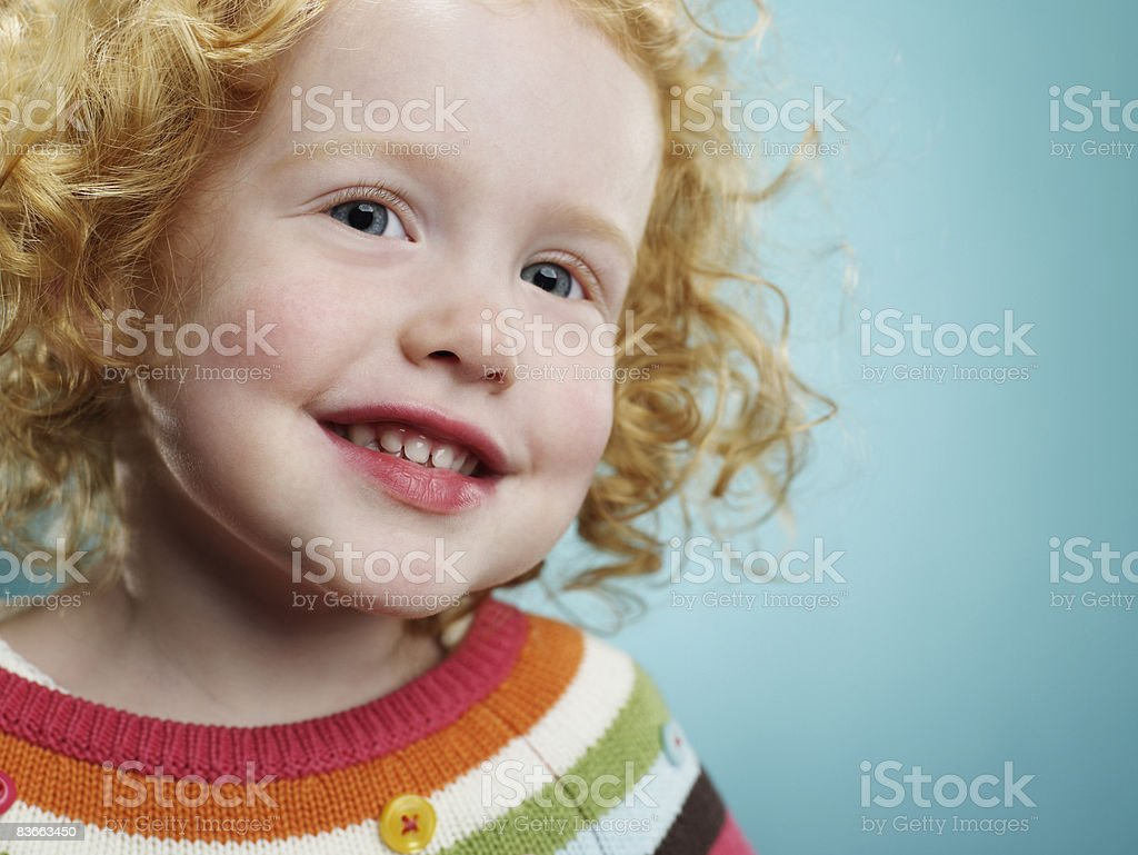 Portrait of a smiling 3 year old girl.  royalty-free stock photo