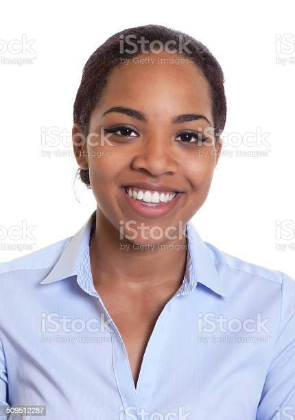Portrait of a smiling african woman in a blue shirt picture id509512287?b=1&k=6&m=509512287&s=612x612&h=i7y7hfdxksoyeo0syfrtuyn7tgevg3 3lvrr9dudfmu=