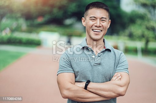 Portrait of a smiling middle aged man in the park