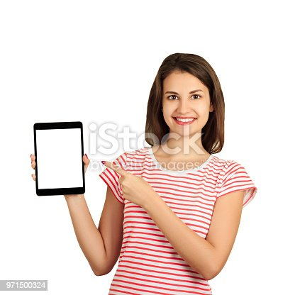 863476166istockphoto Portrait of a smiling attractive girl pointing finger at black screen tablet computer. emotional girl isolated on white background 971500324