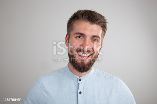 906807208istockphoto Portrait of a smiling bearded business man 1135798452
