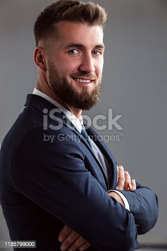 906807208istockphoto Portrait of a smiling bearded business man 1135799000