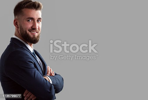 906807208istockphoto Portrait of a smiling bearded business man 1135799077