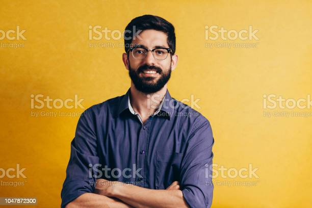 Portrait of a smiling bearded man in eyeglasses looking at camera picture id1047872300?b=1&k=6&m=1047872300&s=612x612&h=ezovakesdnh6dwn0s57 bdy wscisrctdatinq4ybtg=