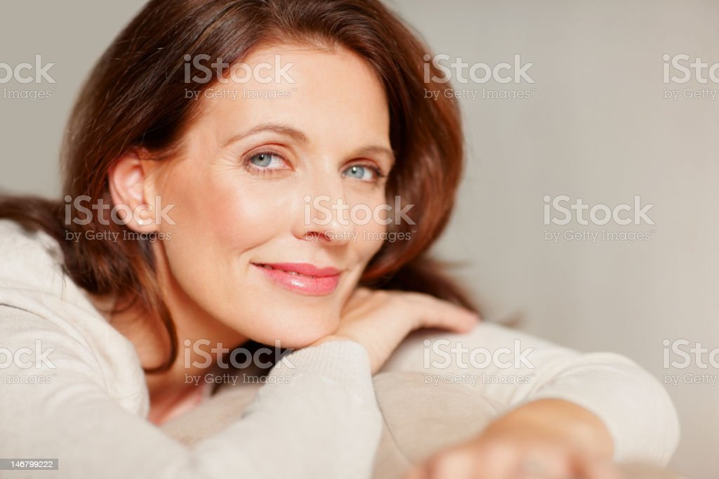Portrait of a smiling beautiful mature lady stock photo