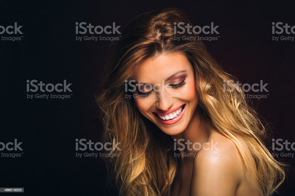 Portrait of a smiling beautiful woman stock photo