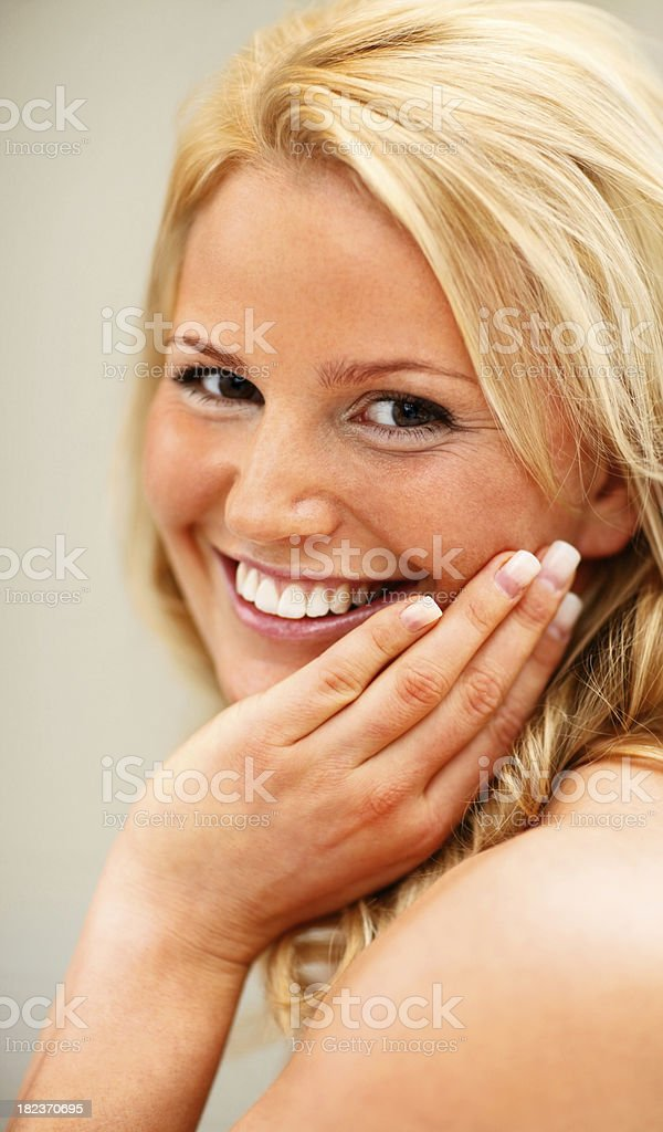 Portrait of a smiling beautiful young lady royalty-free stock photo