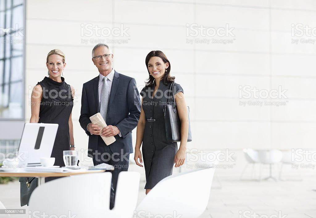 Portrait of a smiling business people standing in office royalty-free stock photo