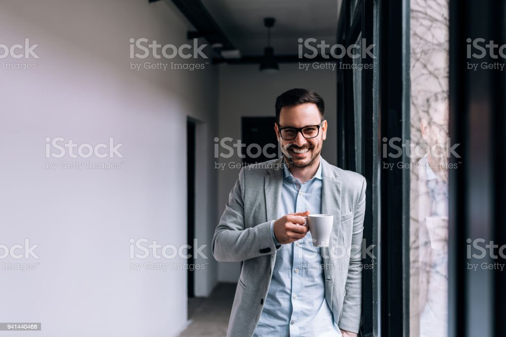 Portrait of a smiling businessman having a break. royalty-free stock photo
