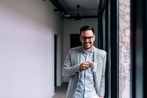Portrait of a smiling businessman having a break.
