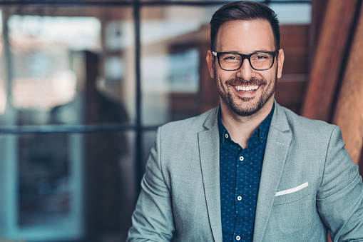Portrait Of A Smiling Businessman Stock Photo - Download Image Now