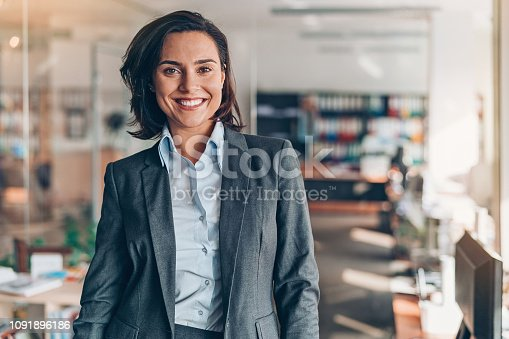 682363912istockphoto Portrait of a smiling businesswoman 1091896186