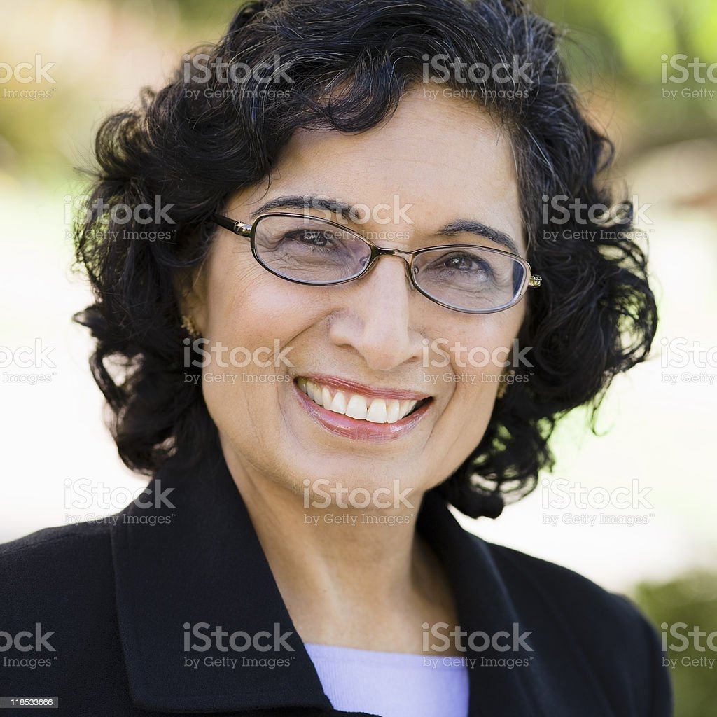 Portrait of a smiling businesswoman wearing glasses stock photo
