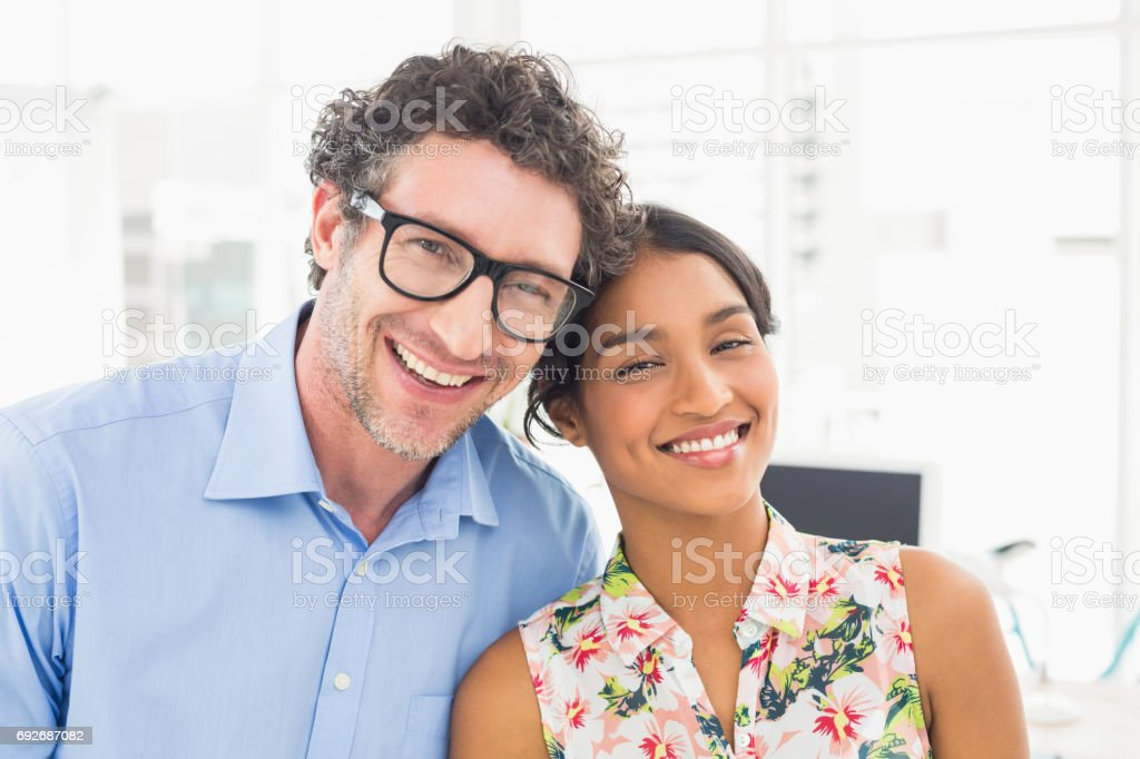 Portrait of a smiling casual young couple at work stock photo