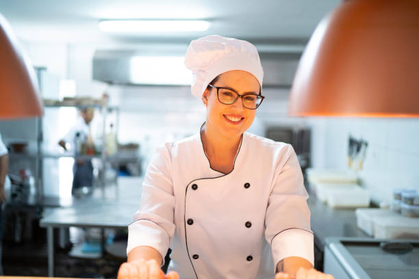 Portrait of a smiling chef looking at camera Portrait of a smiling chef looking at camera chef's whites stock pictures, royalty-free photos & images