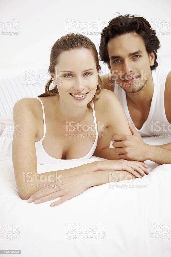 Portrait of a smiling couple lying on bed royalty-free stock photo