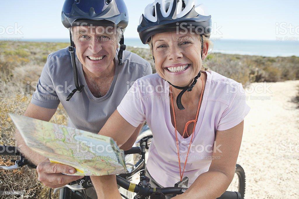 Portrait of a smiling couple mountain biking stock photo