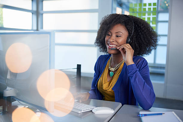 portrait of a smiling customer service representative with an afro - switchboard operator stock photos and pictures