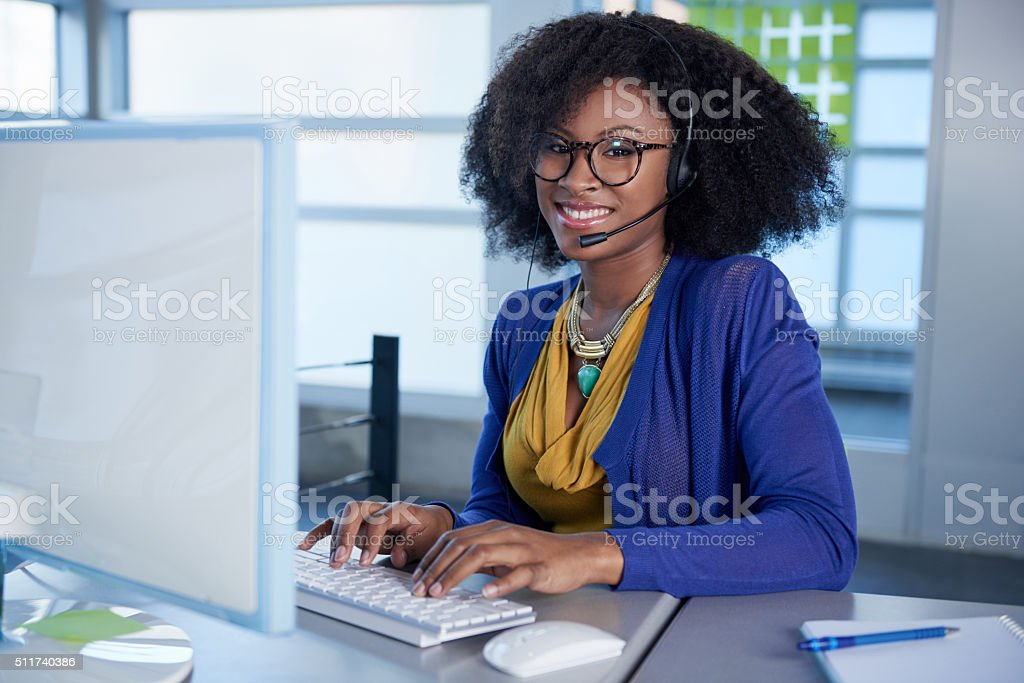 Portrait of a smiling customer service representative with an afro stock photo