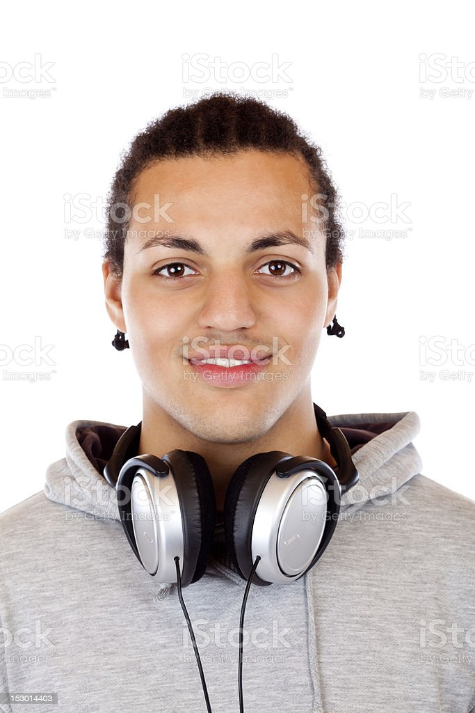 Portrait of a smiling darkskinned young man with headphones royalty-free stock photo