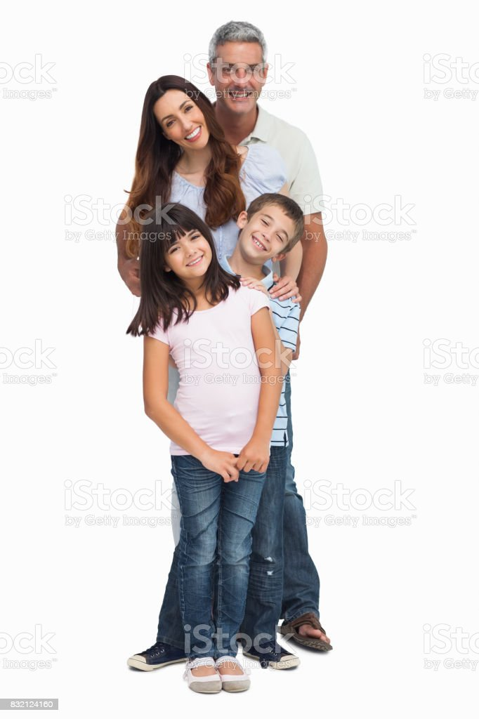 Portrait of a smiling family in single file stock photo