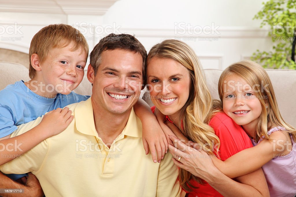 Portrait of a smiling family of four royalty-free stock photo