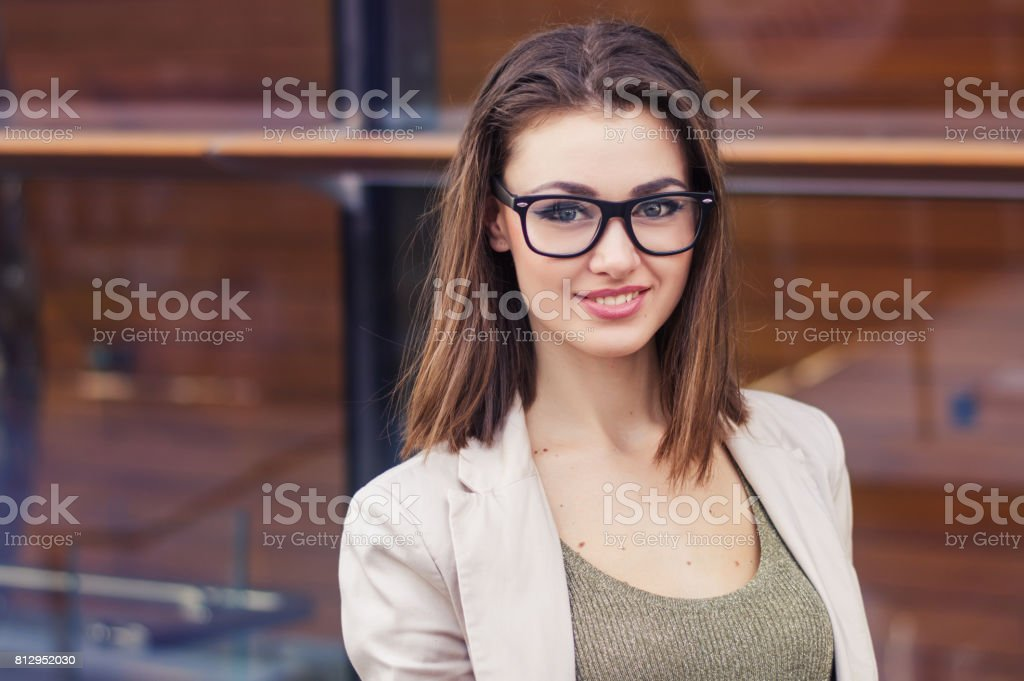Portrait Of A Smiling Female With Short Hair Eye Glasses