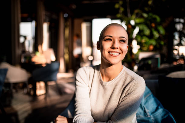 Portrait of a smiling girl with short hair stock photo