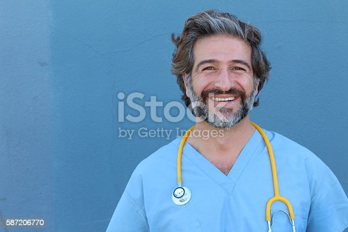istock Portrait of a smiling handsome doctor 587206770