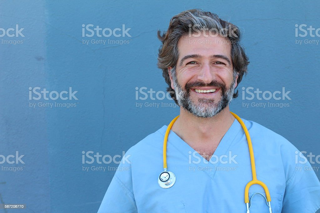 Portrait of a smiling handsome doctor stock photo