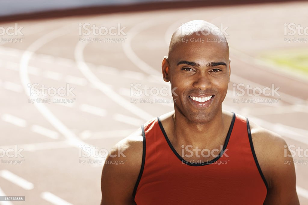 Portrait of a smiling handsome male athlete royalty-free stock photo