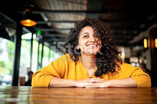 629077926istockphoto Portrait of a smiling Indian woman. 1156932301
