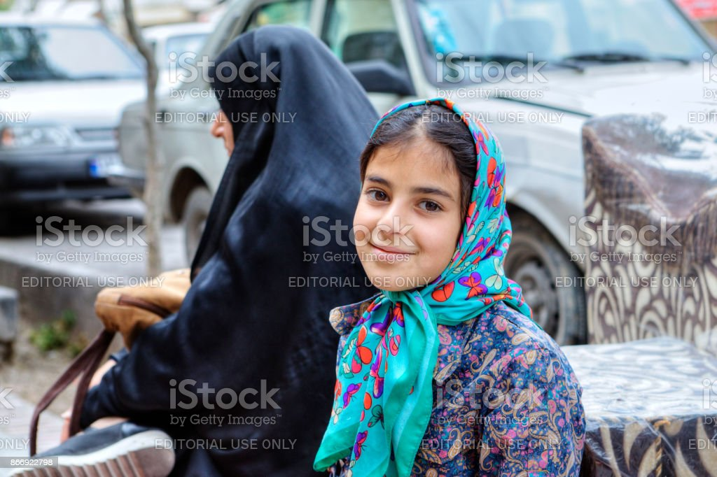 Portrait of a smiling Iranian teenage girl in hijab, Shiraz. stock photo