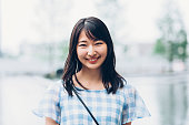 Portrait of a beautiful smiling Japanese girl outdoors