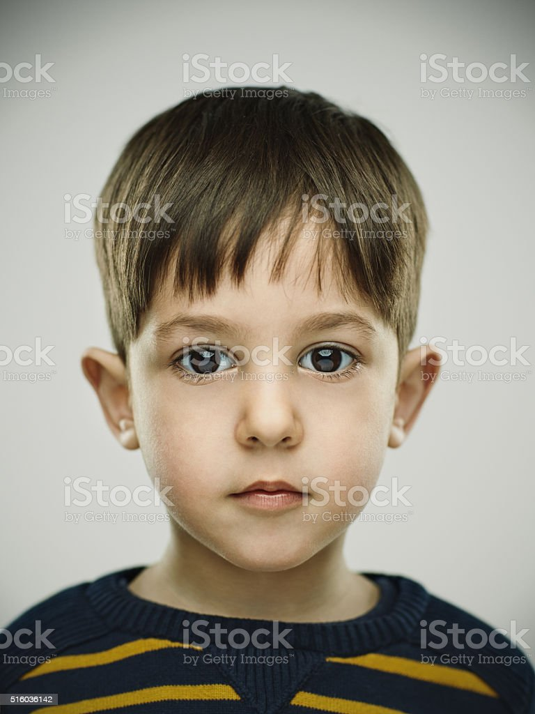 Portrait of a smiling kid looking at camera. stock photo