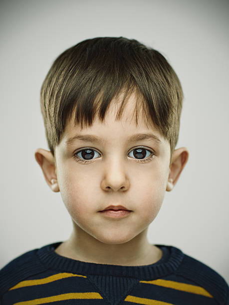 portrait of a smiling kid looking at camera. - baby boys stock photos and pictures