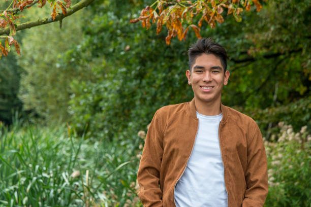 Portrait of a smiling  Latin American young man stock photo