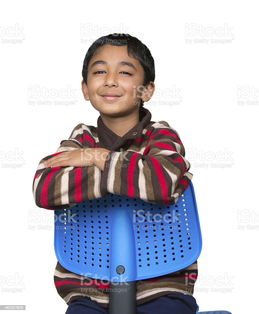 Portrait of a Smiling Little Boy Sitting Reverse on Chair stock photo