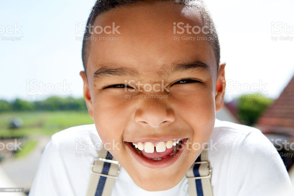 Portrait of a smiling little boy with suspenders stock photo