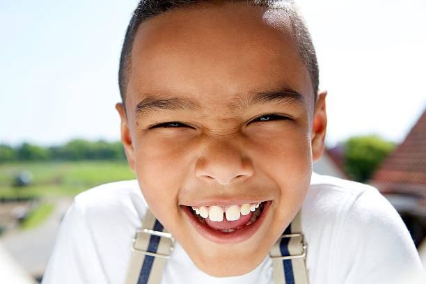 portrait of a smiling little boy with suspenders - pantolon askısı stok fotoğraflar ve resimler