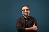 istock Portrait of a smiling man of Indian ethnicity 1277971635