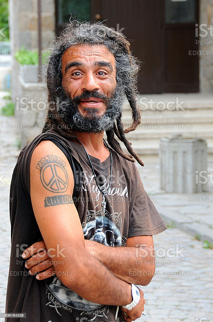 Portrait of a Smiling Man with Dreads stock photo