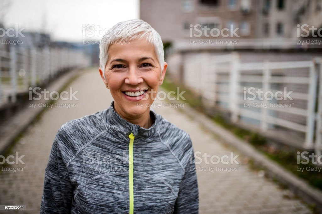 Portrait of a smiling mature woman stock photo