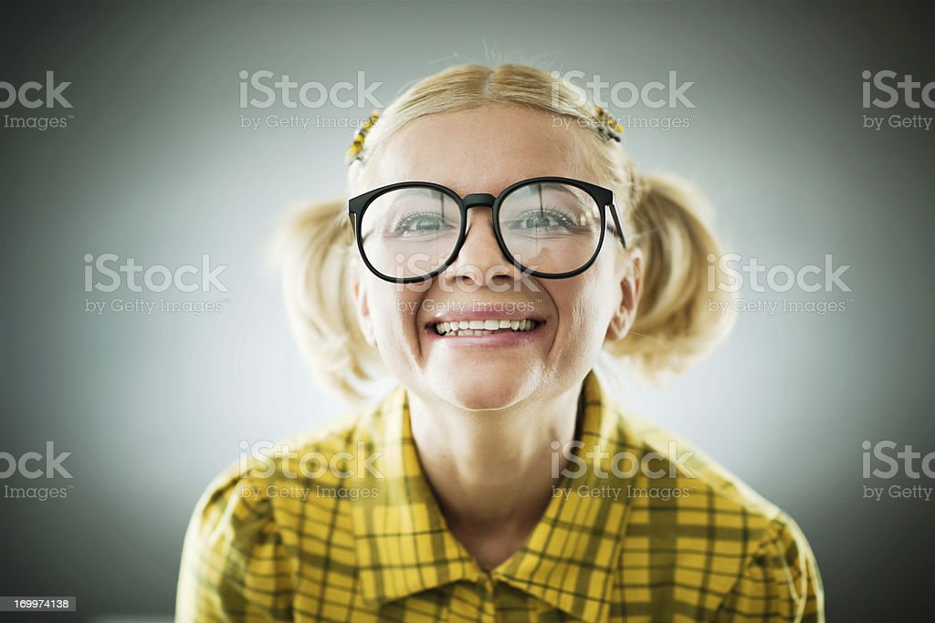 Portrait of a smiling nerd wearing glasses. stock photo