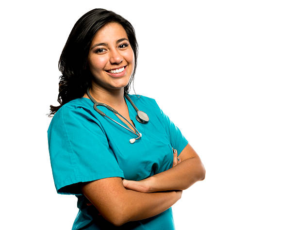 portrait of a smiling nurse i scrubs with a stethoscope - female nurse stock photos and pictures