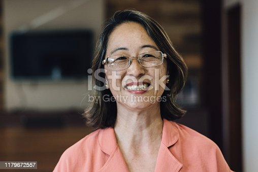 Portrait of a smiling oriental mature woman