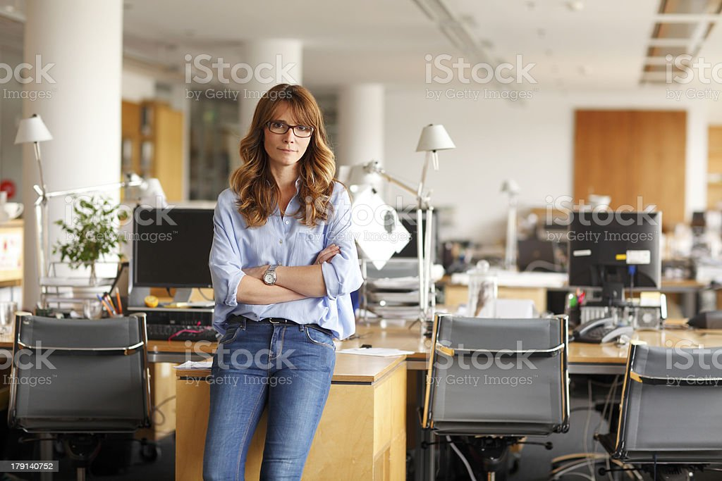 Portrait of a smiling professional mature businesswoman stock photo