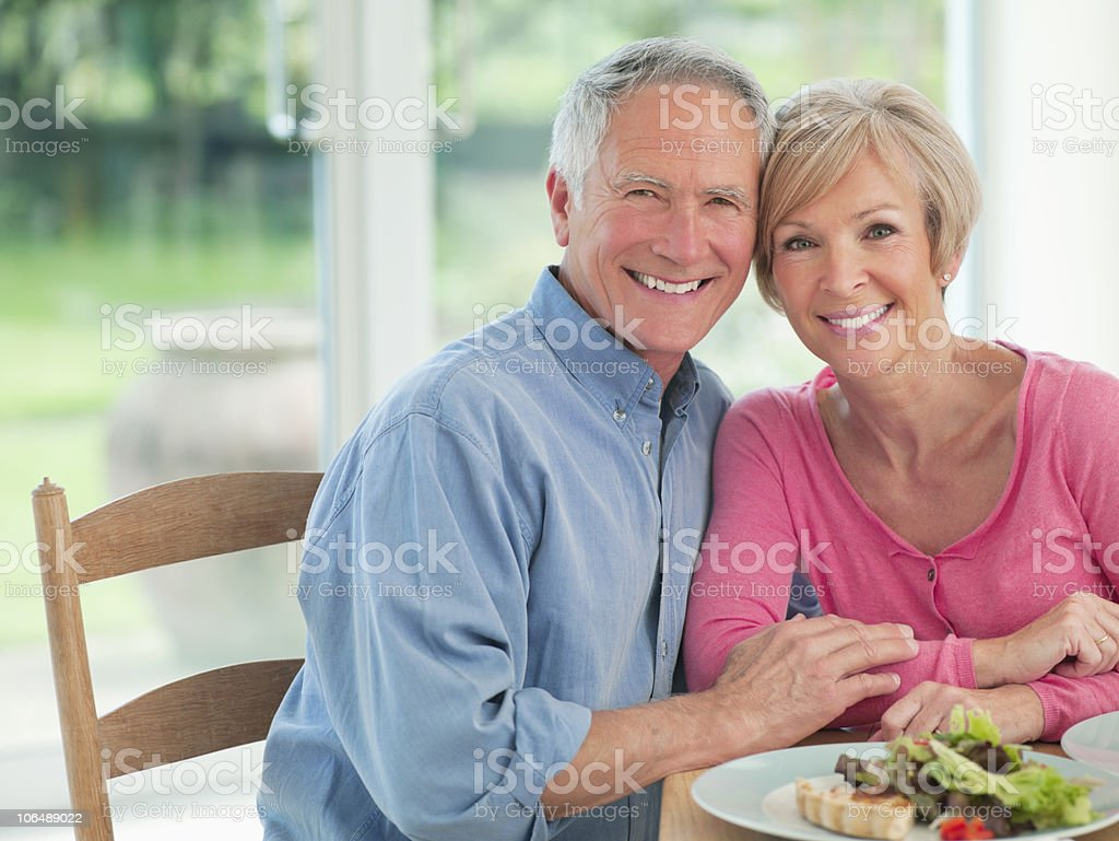 Portrait of a smiling romantic couple together at dining table royalty-free stock photo